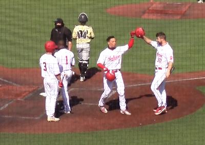 Hopkins celebrates home run vs Purdue